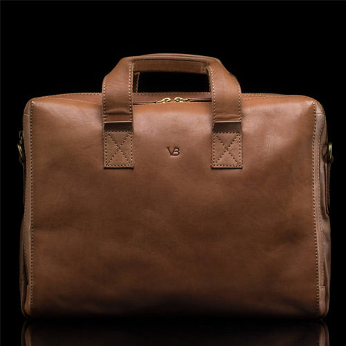 tan leather briefcase with monogrammed logo
