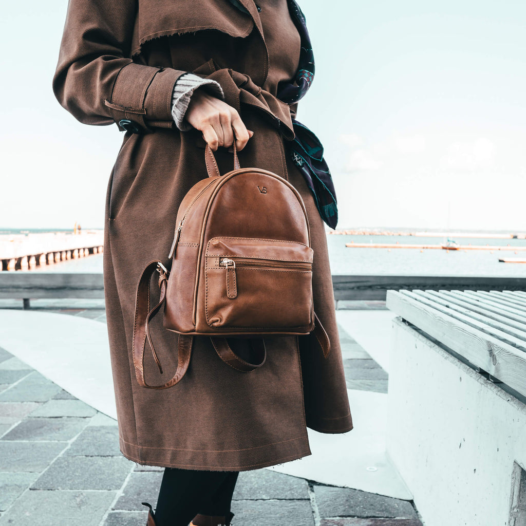 women carrying bella leather backpack on the way to work
