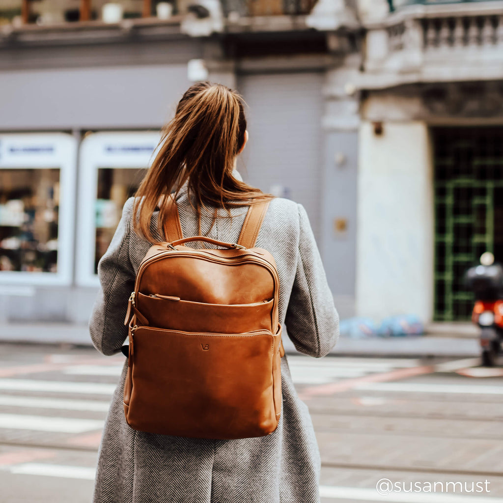 women wearing liberty leather backpack while commuting to work