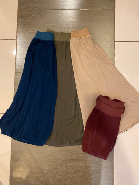 Pictured in order from right to left is river blue, olive, camel, and bordeaux (folded on bottom right-hand corner).