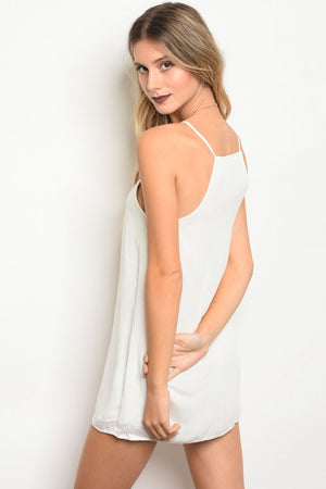 Women's summery embroidered mini dress in white.