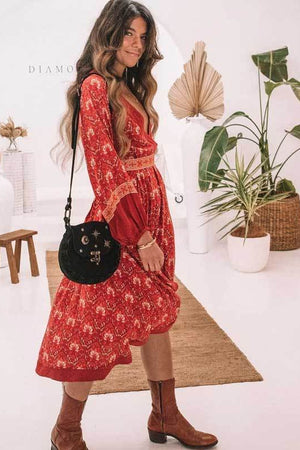 This gorgeous boho red midi dress is patterned with lantern sleeves and an asymmetrical hemline.