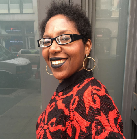 Photo of Krystal, our newsletter creator, wearing a black and red patterned sweatshirt