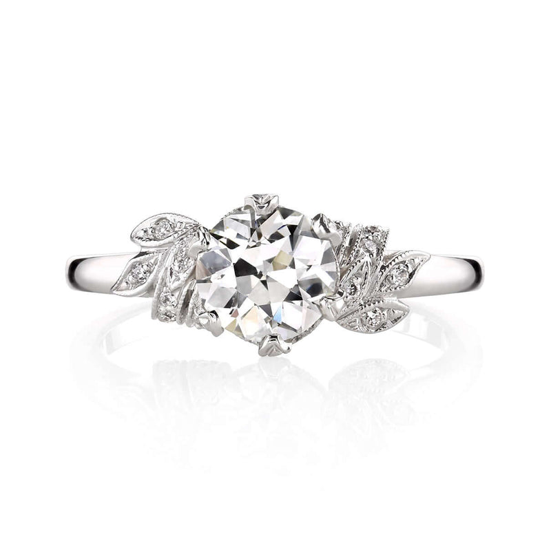 PLATINUM RING WITH FLORAL DETAIL WITH 0.07CT ACCENT DIAMONDS SURROUNDING A 1.00CT OLD EUROPEAN CUT DIAMOND | SINGLE STONE