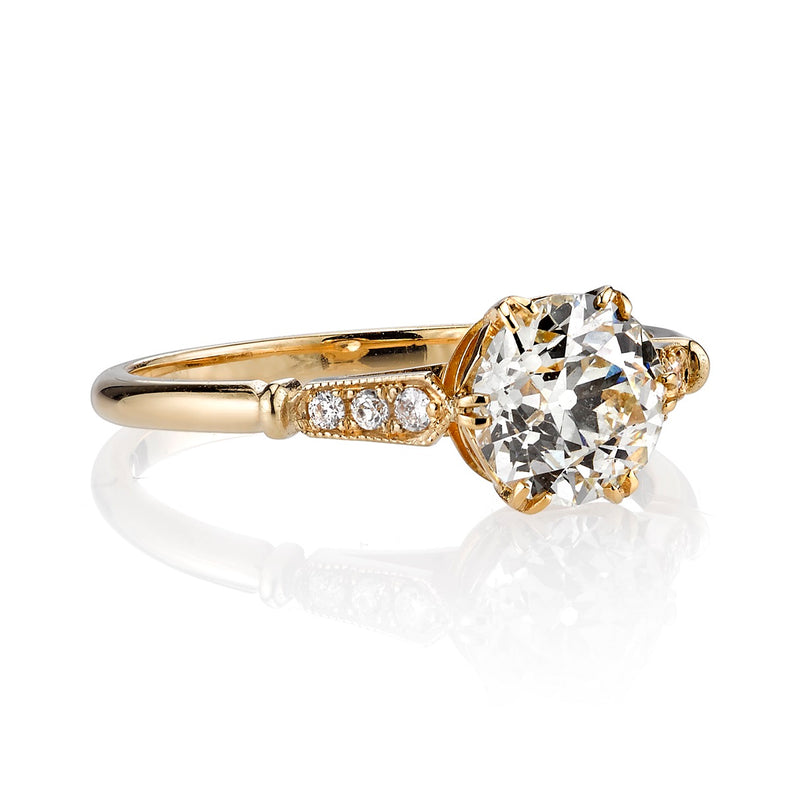 SIDE VIEW OF AN 18K YELLOW GOLD DIAMOND RING SHOWCASING SHANK DETAIL | SINGLE STONE