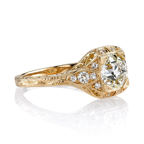SIDE VIEW OF 18K YELLOW GOLD DIAMOND RING SHOWCASING ACCENT STONES AND ENGRAVING DETAIL ALONG SHANK | SINGLE STONE