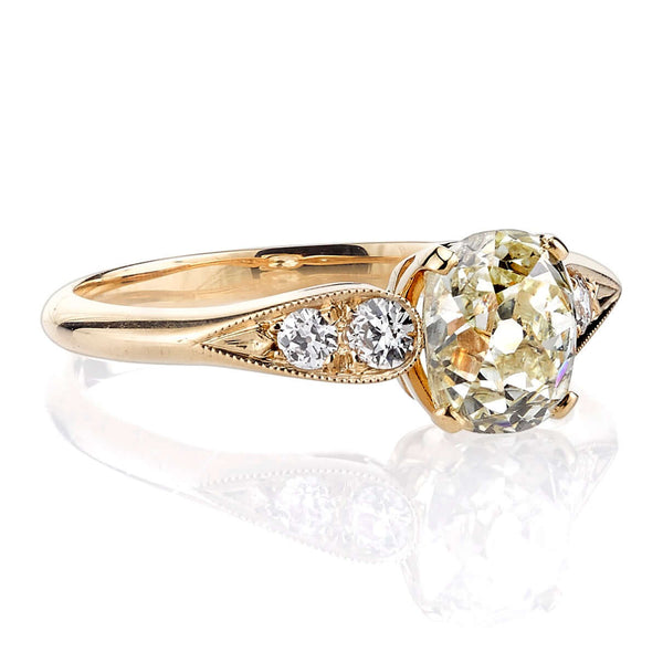 SIDE VIEW OF 18K YELLOW GOLD DIAMOND RING SHOWCASING ACCENT DIAMONDS | SINGLE STONE
