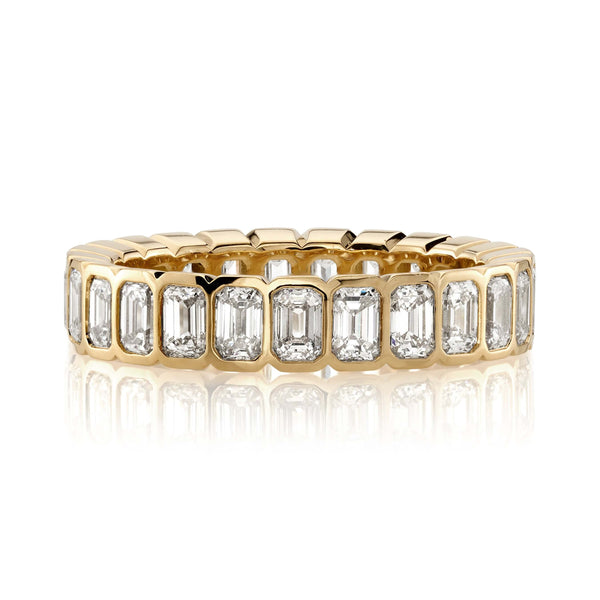 APPROXIMATELY 2.45CTW EMERALD CUT DIAMONDS ARRANGED IN A NORTH SOUTH PATTERN BEZEL SET IN AN 18K YELLOW GOLD RING | SINGLE STONE