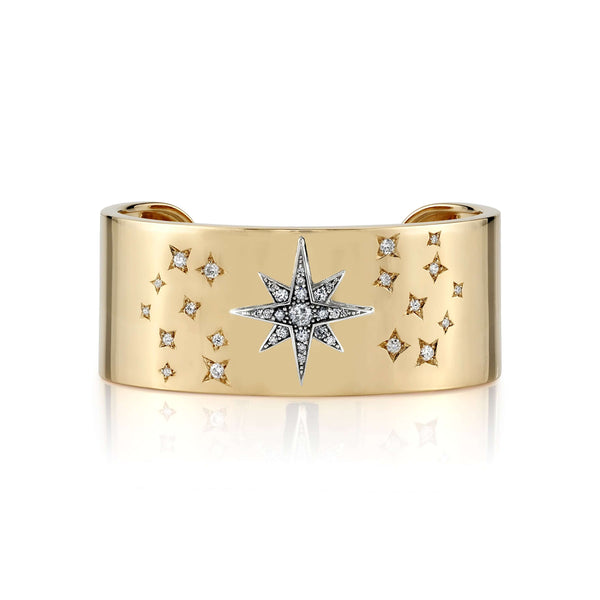 1.15CTW OLD EUROPEAN, OLD MINE, AND ROUND BRILLIANT CUT DIAMONDS ARRANGED IN A STAR MOTIF SET IN AN 18K YELLOW GOLD CUFF | SINGLE STONE