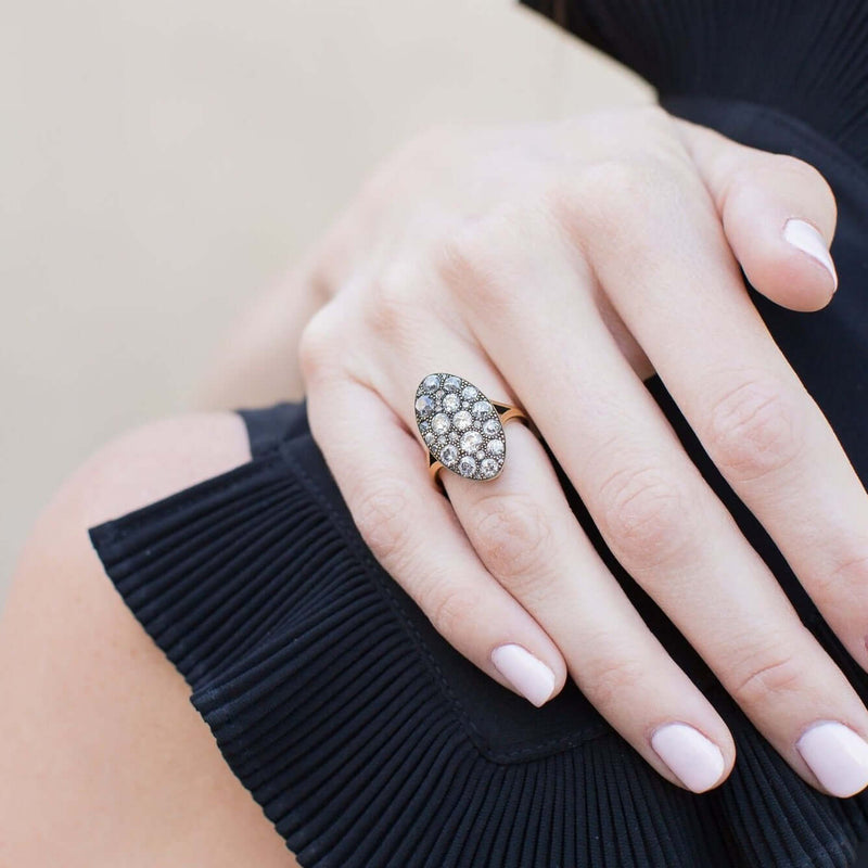 WOMAN'S HAND DRAPED OVER SHOULDER SHOWCASING DETAIL OF RING | SINGLE STONE