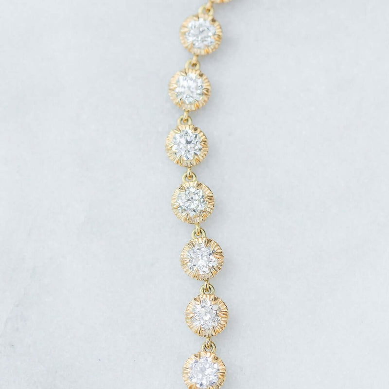 18K YELLOW GOLD DIAMOND BRACELET LAYING OUT IN A STRAIGHT LINE | SINGLE STONE