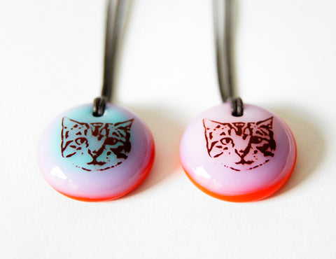 cute tabby cat face pendant necklaces in bright blue, pink and red recycled glass