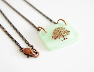 Mint green glass pendant on vintage style copper chain