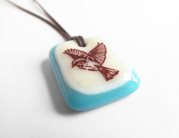 Freedom bird image on a handmade glass pendant necklace.