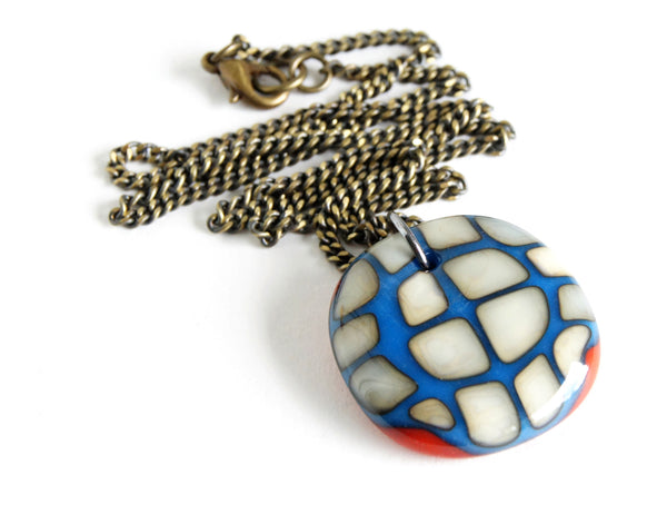 Large bold statement pendant necklace handmade in royal blue and red glass on dark brass chain