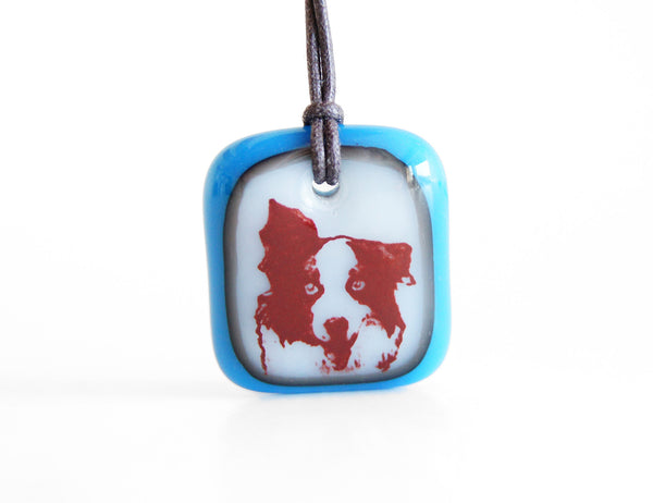 Border Collie necklace handmade in cloud white and royal blue glass.