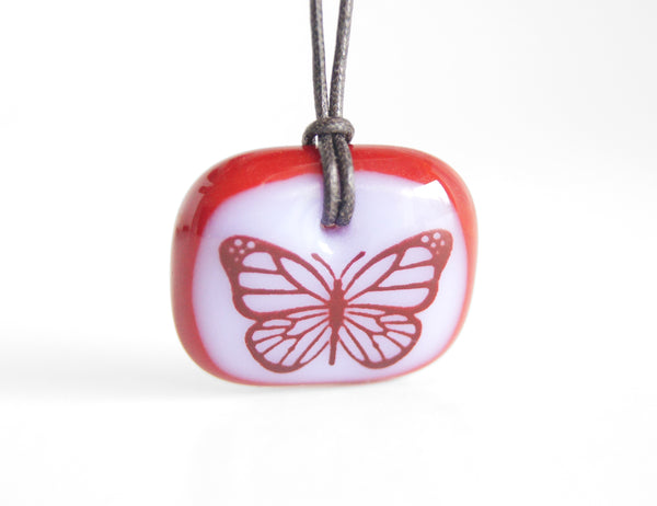 Monarch Butterfly Necklace in rose pink and red glass.