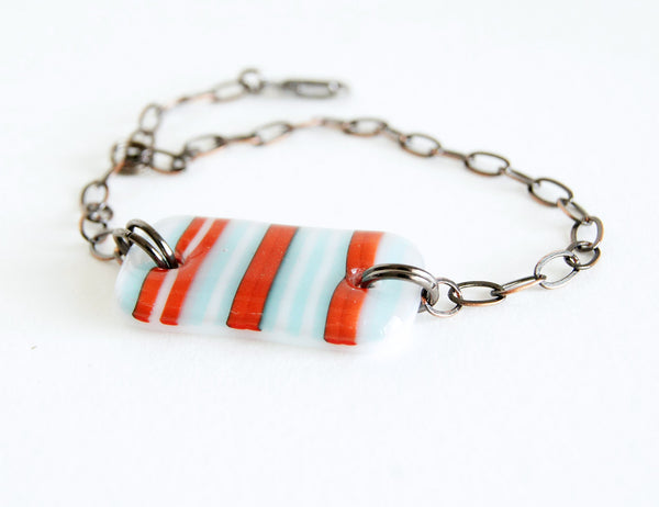 Red, white and blue (pale aqua) striped handmade glass adjustable bracelet.