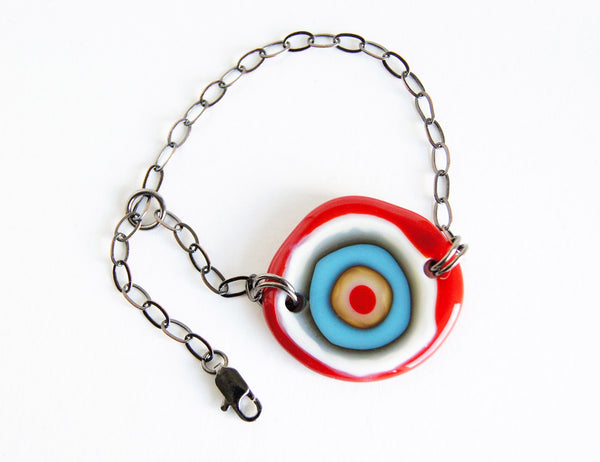 Fun, bold red and blue handmade glass disc bracelet.