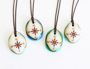 Limited batch of colourful glass compass necklaces