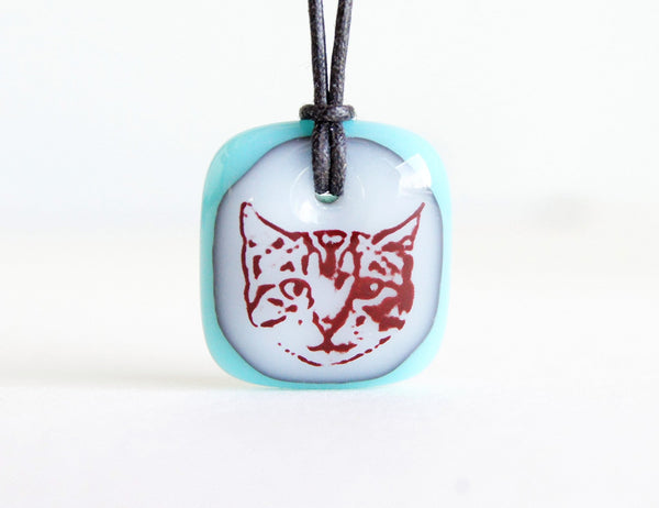 Cute tabby cat face necklace in turquoise.