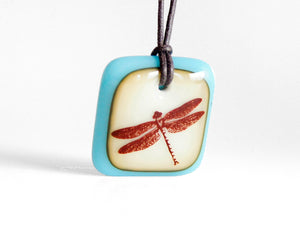 Dragonfly necklace in vintage aquamarine and caramel glass.