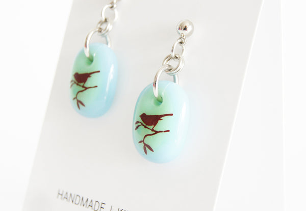 Handmade bird earrings on gift cards.