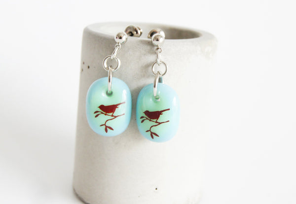Songbird earrings in pale blue and green glass.