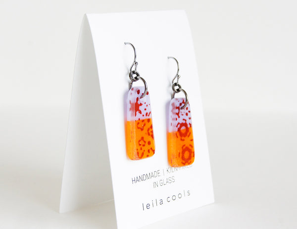 colorful orange and lavender purple glass earrings with sepia pattern design, handmade