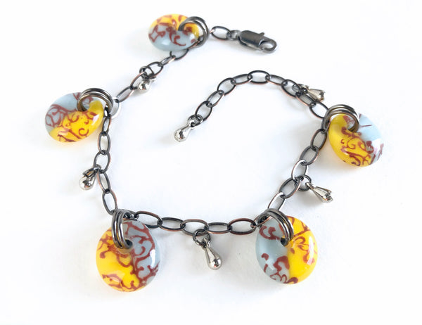 Sunny yellow and light blue glass charm bracelet.