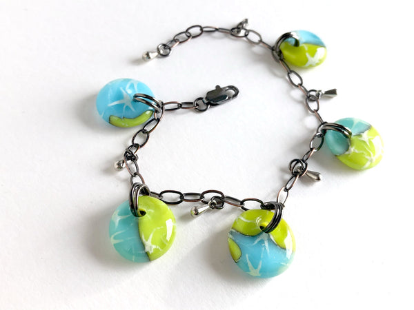 Handmade glass drop bracelet in blues and greens with bronze chain and small steel glass drop beads.