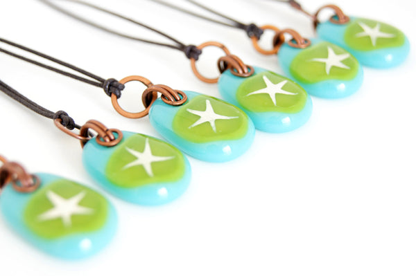 Painted silver star on green glass jewelry.