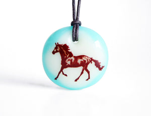 Horse necklace in aqua blue glass.