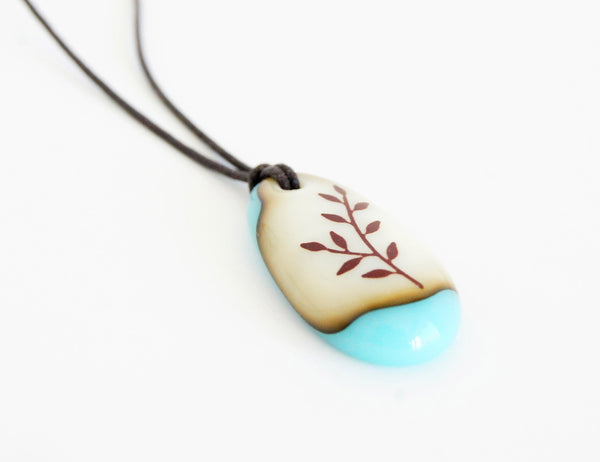 Botanical necklace in vintage colours turquoise glass.