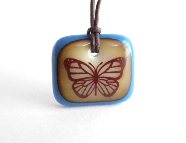 Monarch Butterfly Necklace in caramel and Teal Blue.