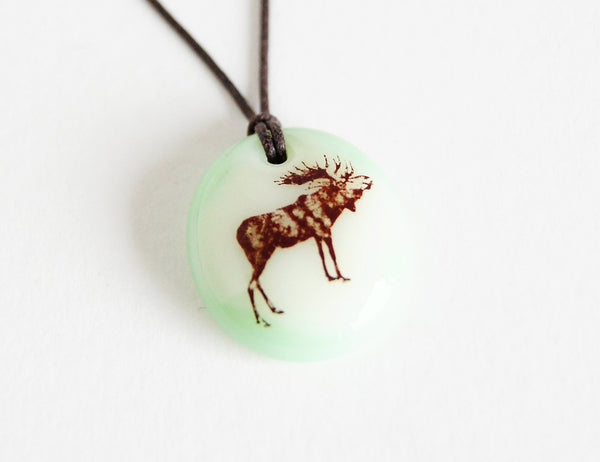 Moose necklace handmade in light green glass.