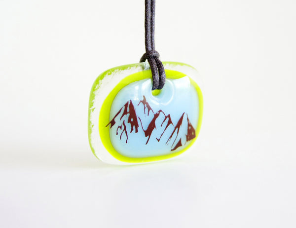Mountain necklace with three peaks mountain range.