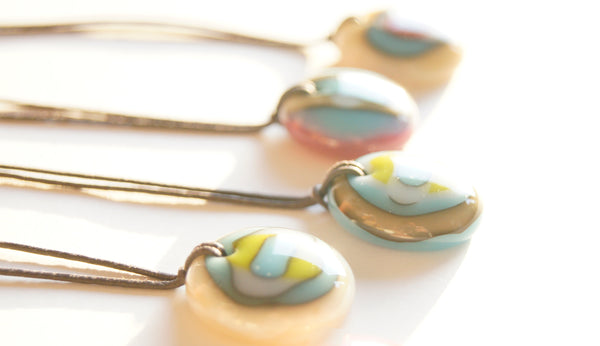 Colorful handmade art glass necklaces.