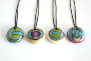 Whimsical art glass pendant necklace.