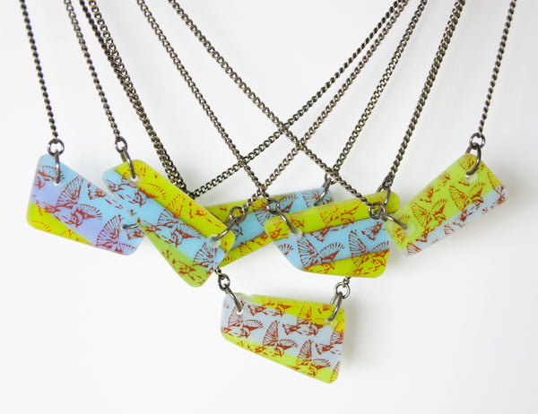 Handmade collection of one of a kind flying bird necklaces.