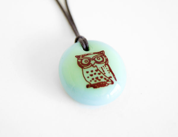Owl pendant necklace in mint green and light blue.