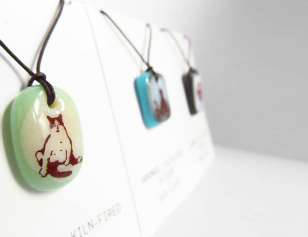Leila Cools' necklaces displayed on retail cards.