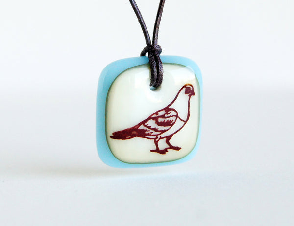 Pigeon necklace in vanilla and ice blue, handmade in glass