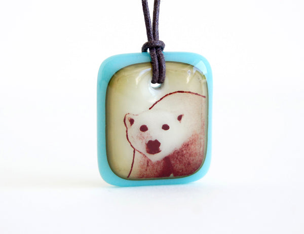 Polar bear necklace turquoise and vintage caramel glass.