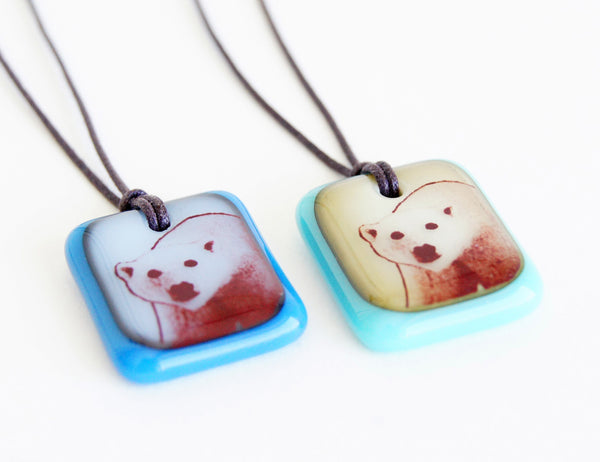 Handmade polar bear photo pendants.