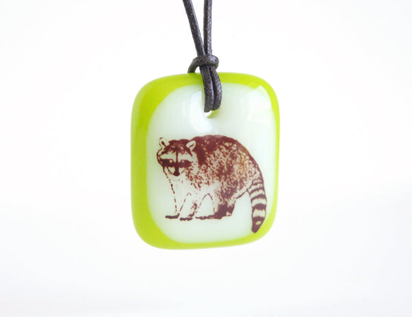 Raccoon necklace in cream and spring green colours.