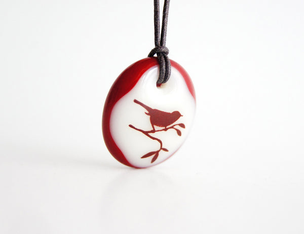 Bird in tree necklace handmade in glass.