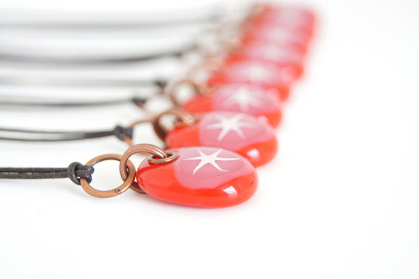 Star jewelry in red and rose pink glass.