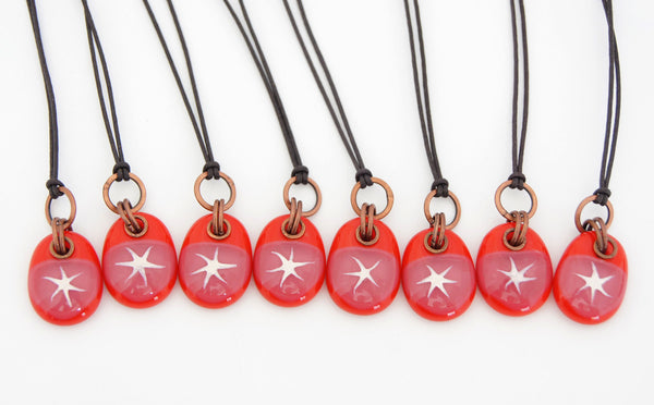Handmade painted star pendants on cotton cord.