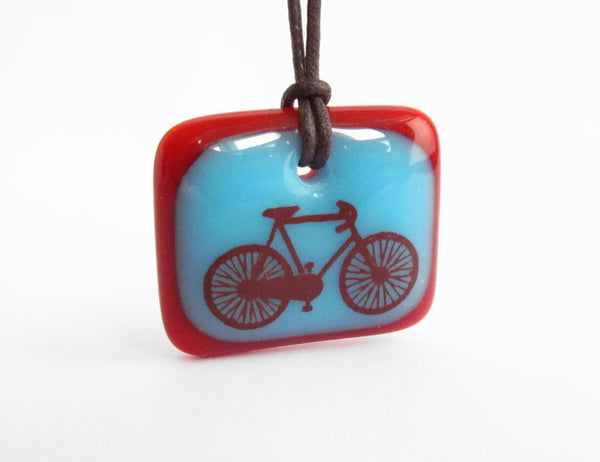 Colorful bicycle necklace handmade in aqua blue and red.